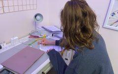 Junior Zoe Fischman works on her math homework during an asynchronous period.