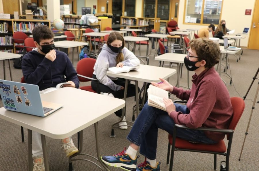 Students participate in a class discussion in-person. Many view in-person learning time as crucial for education.