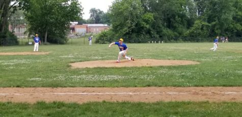 Junior Zackary Shpilman warms up during the last baseball game in his high school career.