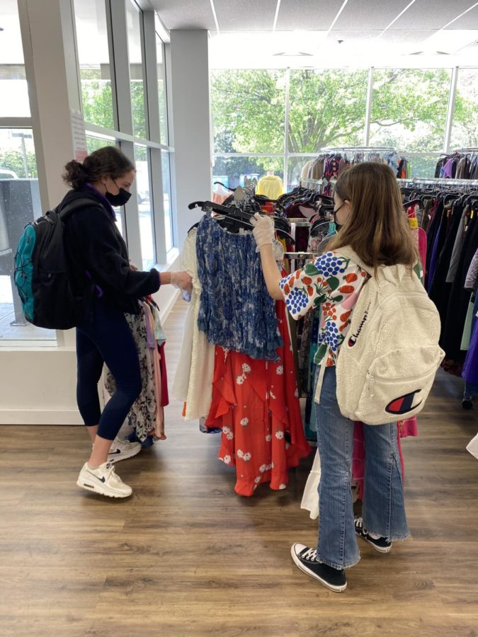 Freshmen Olivia Cohen and Hannah May search through the aisles for second hand clothes at the Salvation Army Thrift Store.