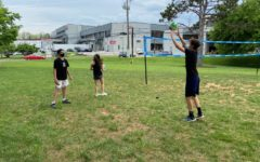 Ninth graders Todd Lazoff and Itai Topolovsky enjoy passing around a volleyball during practice.