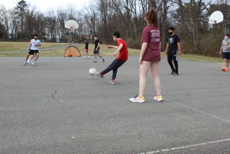 Soccer players scrimmage during practice as part of their routine.