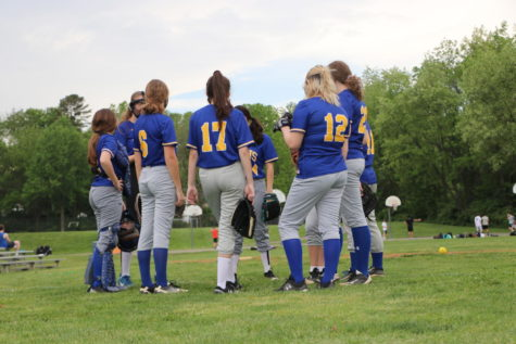 Softball athletes come together before the game begins.