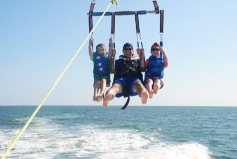 Learning specialist Brett Kugler and his family parasailing.