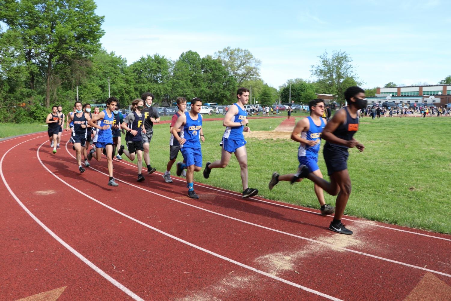 Track athletes compete against other schools during their first meet of the season.