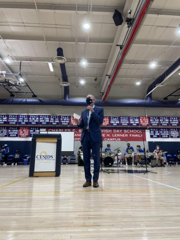 Head of School Rabbi Mitchel Malkus gives a speech to high-school students during the first multi-grade assembly since the pandemic began. There were multiple speakers, and Shir Madness performed as well.