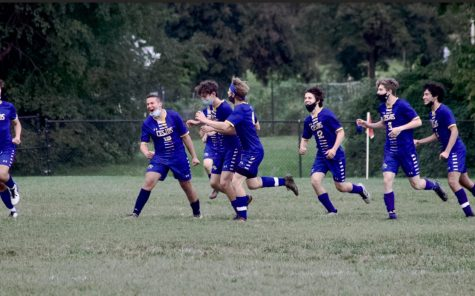 The Lions celebrate a goal scored by sophomore Ari Werbin early in the first half. The Lions lost the game 2-1 against Washington International School.