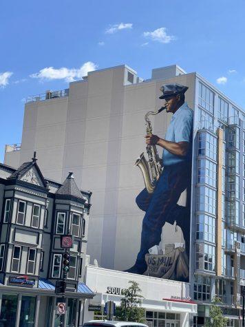 A U-Street mural depicting musician and mailman Buck Hill.