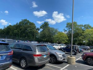The carpool line running through the student parking lot as students try to leave school.
